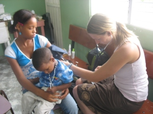 My daughter, Becky, the nurse using her 'doctor's stethoscope' in a clinic in the Dominican Republic